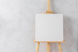 canvas print picture - Wooden easel in the room