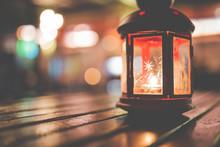 Abstract Candle Lantern Light On Wood Table In Blur Bokeh Pub Restaurant Dinner Background Concept For Ramadan Kareem Night Life, Wooden Tabletop Dark Indoor Counter, Happy Kid Mubarak.