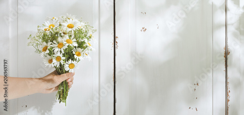 Hand holding bouquet of flower