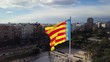 Valencian Flag on the background of the city. Flag waving in the wind