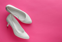 White Wedding Shoes On Pink Background