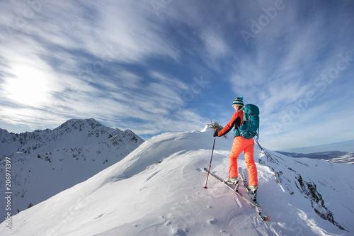 Aluminium Prints Mountaineering A skier walks in the mountains