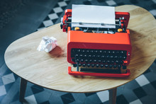 Red Typewriter And Crumpled Pa...