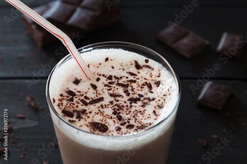 Foto op Aluminium Milkshake Chocolate milk shake and chocolate crumbs on wooden backgr