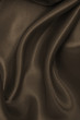 Smooth elegant brown silk or satin texture as abstract background. Luxurious background design wallpaper. In Sepia toned. Retro style