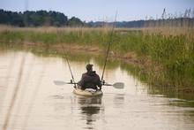 Fisherman In Canoe.