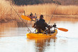 Recreational fishermen in small kayak.