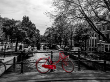 Red Bicycle Standin On A Bridge, Black And White