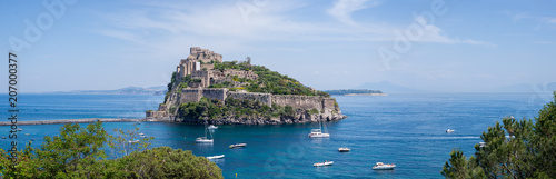 Fotografía Ancient castle on the island in the blue sea panorama Ischia