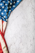 canvas print picture Close-up american flag on white marble background