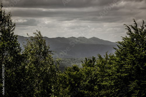 Foto op Canvas Zwart dramatic mountain ridge horizon landscape