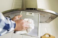 Man's Hands Cleaning Aluminum ...