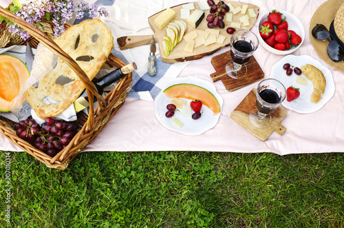 Spoed Foto op Canvas Picknick Summer picnic with cheese, wine, fruits and bread.