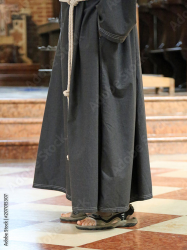 Fototapeta barefoot friar with sandals in the church