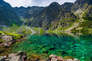 Fototapeta Góry transparent water of a clean mountain lake Czarny Staw in the Tatras