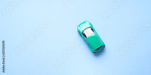Fotografie, Obraz  Green toy car on abstract blue background