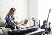 Female Musician Composing Music At Home