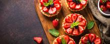 Strawberry Tart On Dark Table.