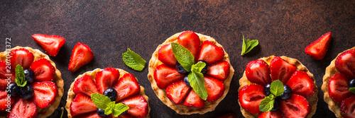 Fotografia, Obraz  Strawberry tart on dark table.