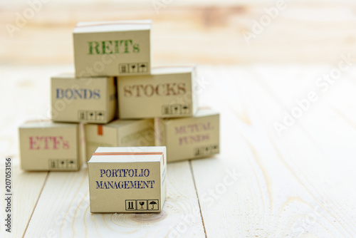 Portfolio and wealth management with risk diversification concept : Small paper cartons / boxes of financial instruments i Wallpaper Mural