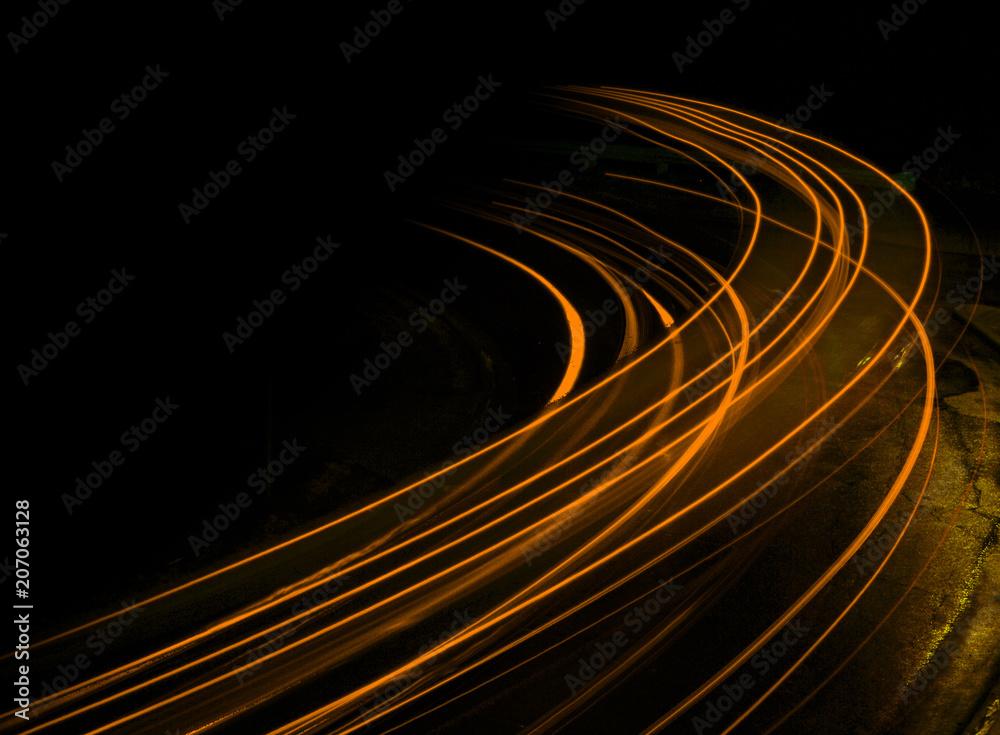 Fotografie, Obraz Long exposure at night orange streaks
