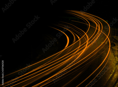 Canvas Print Long exposure at night orange streaks
