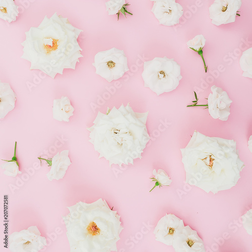 Foto op Plexiglas Bloemen Floral composition with white roses on pink background. Flat lay, top view. Pastel background.