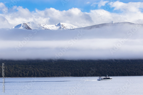 Foto op Plexiglas Oceanië long white cloud and traveling boat in lake te anau most popular traveling destination in southland new zealand