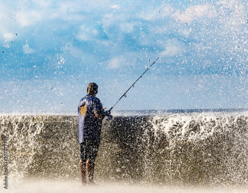 Staande foto Havana Fishermen stand their ground as waves crash over the Malecon wall in Havana