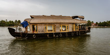 Bamboo Thatched Houseboat Floats Down The Backwaters Of Kerala