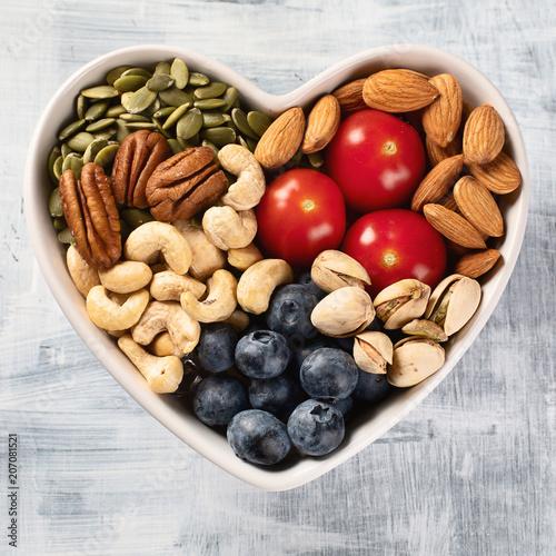 Healthy snack in heart shaped bowl Obraz na płótnie