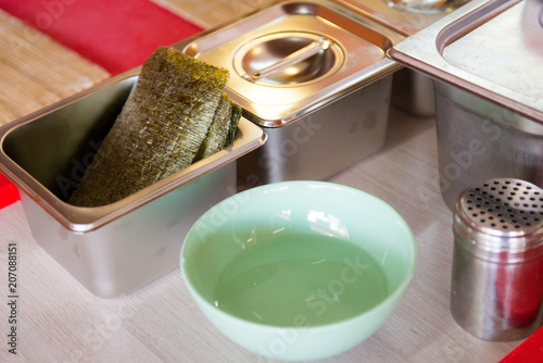 Foto op Aluminium Assortiment Accessories for making sushi and rollow on the table. Japanese cuisine.