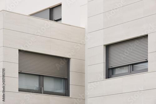 New building exterior facade with tiles. Construction. Buy