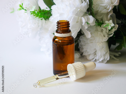 Argan Oil Bottle With A Pipette White Flower From The Front Buy