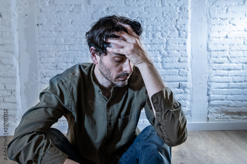 Fotografía  sad depressed man leaning against a wall in mental health concept