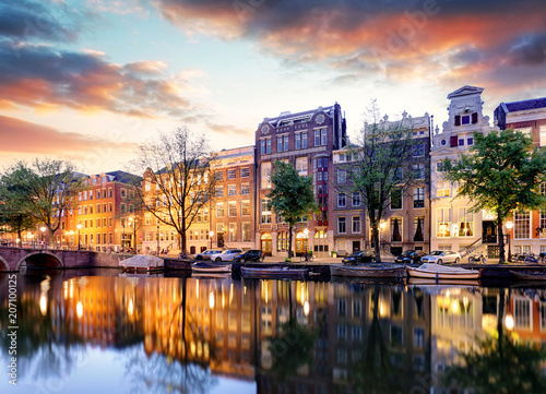 Photo Stands Amsterdam Amsterdam Canal houses at sunset reflections, Netherlands