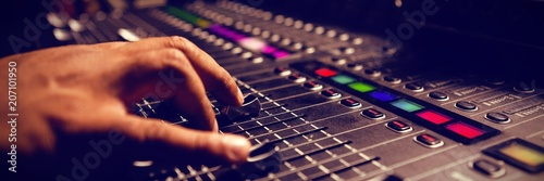 Cropped hand of musician using sound mixer Canvas Print
