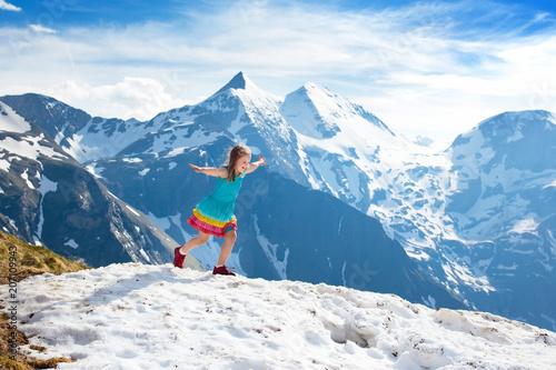 Staande foto Nepal Child hiking in mountains. Kids in snow in spring.