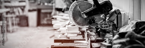Obraz Grinder cutting machine and wooden pieces - fototapety do salonu