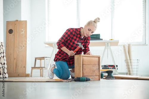 Young women repairing furniture at home