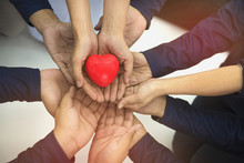 Group Of Hands Holding Red Hea...