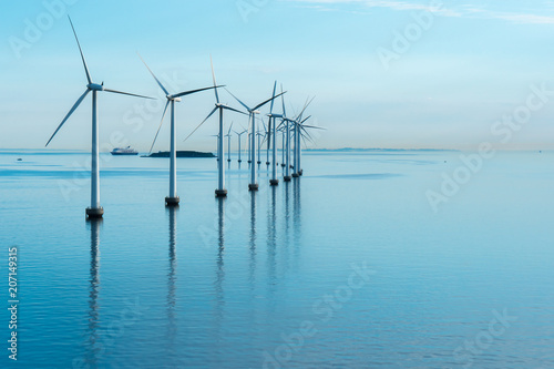 Printed kitchen splashbacks Light blue windmills in the sea with reflection