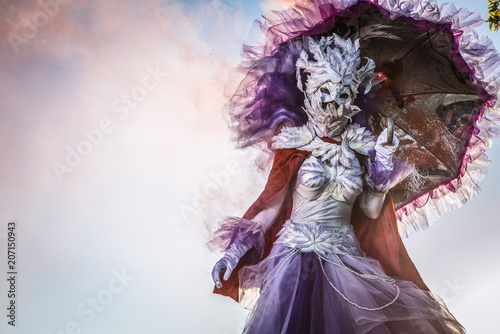 Valokuva Fairy tale woman on stilts in bright fantasy stylization