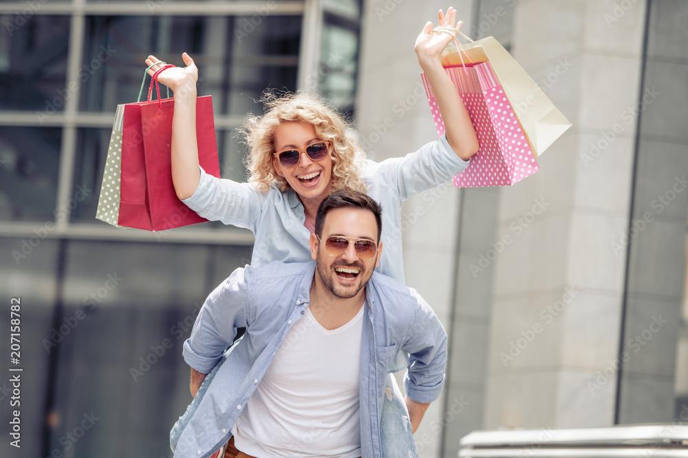Fototapeta Couple with shopping bags