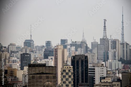 Fototapeta TV antennas on top of buildings in a metropolis skyline obraz na płótnie