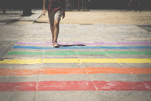 Boy Crossing Rainbow Pedestrian Crossing