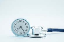 Close Up Of Vintage Round Clock On Stethoscope On White Background. Health Care And Time Concept.