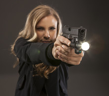 Woman Pointing A Gun With A Li...