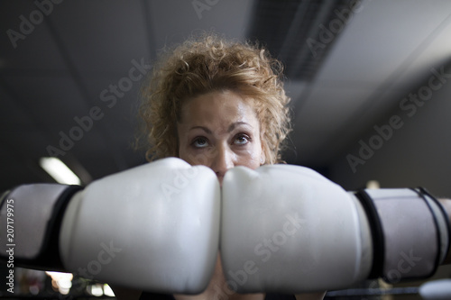 Strong female body with boxing gloves