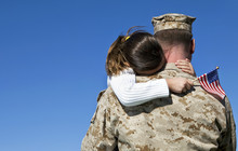 Military Man Hugging His Daugh...